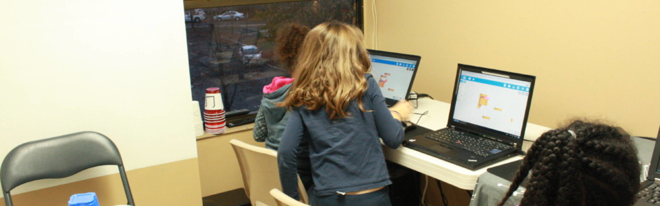 Students working on coding projects